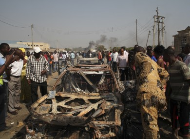 The scene of yesterday's bomb explosion at St Theresa's church in Madalla, Nigeria..
