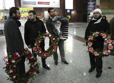 A group of demonstrators waits at Tehran airport to welcome the Iranian diplomats expelled from Britain.