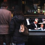 A couple stop to watch a television outside a pub in Dublin as Finance Minister Michael Noonan delivers his Budget. Photo: Niall Carson/PA Wire