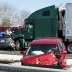 Wrecked vehicles sit along the road at the scene of a multi-vehicle accident. (AP Photo/Phil Sandlin)