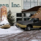 L.L Bean employee Randy Reynolds, of Freeport, Maine takes a photo of the  companys Bootmobile outside the headquarters of the outdoor retailer in Freeport, Maine (AP Photo/Pat Wellenbach)