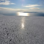 The sun itself looks like an ice crystal in this glacial scene:  the first pack of ice floe in this season is observed from Yomiuri's jet liner near the Notori Cape in the shores of Okhotsk, Hokkaid. (The Yomiuri Shimbun via AP Images )