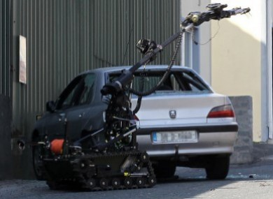 File photo of a bomb disposal robot examine a suspect device in a car