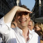 The Portuguese prime minister is nearly blinded by the whiteness of his own shirt (AP Photo/Armando Franca)