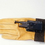 A small pistol with glove for convenient concealment. (Image via photoshtab.ru)