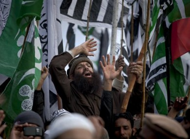 A supporter of a Pakistani religious party shouts religious slogans during a rally in Rawalpindi on Sunday, Jan. 22, 2012, when many Islamists rallied against the US and India.