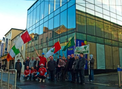 The protest group outside the 'liberated' building