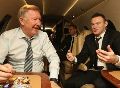 Celebrations: Fergie and Rooney share a box of sweets.