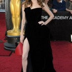 The original... Angelina Jolie poses on the red carpet outside Sunday's Oscars.