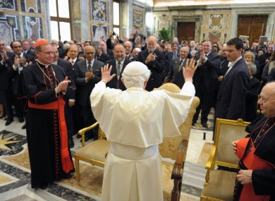 The Pope greets a private audience at the Vatican on Saturday.