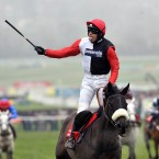Ruby Walsh sticks his tongue out in celebration as Big Buck's wins the World Hurdle Race at Cheltenham for a fourth successive year.