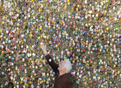 Retired German couple Volker and Christa Kraft decorate a tree in their garden with 10,000 Easter eggs today. They've continued the tradition for more than forty years.