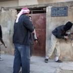 Free Syrian Army fighters take cover during fierce fighting against government troops in Idlib, north Syria, Saturday, March 10, 2012. (AP Photo/Rodrigo Abd)