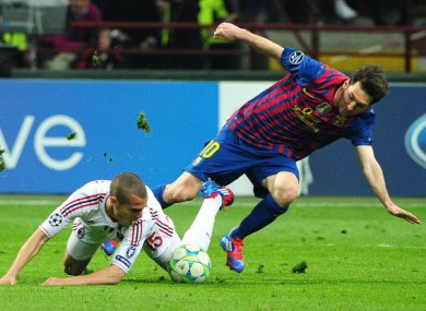Messi under pressure at the San Siro last night.