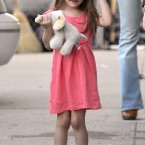 Young fashionista, Suri Cruise, who reportedly has a rather expensive purse for her age. (Cau-Guerin/ABACA USA/Empics Entertainment)