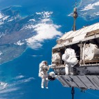 Astronaut Robert L Curbeam Jnr and ESA astronaut Christer Fuglesang carry out a spacewalk high above New Zealand in December 2006. (Image: NASA)