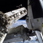 For a sense of scale, there's Discovery's astronaut Noguchi at the bottom of the photo amid a spacewalk alongside the ISS and Discovery in 2005. (Image: NASA)