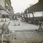In this circa 1890 photo provided by the New York City Municipal Archives, a pair of girls walk east along 42nd Street in New York. Acker, Merrall and Condit wine shop delivery wagons are on the right and the C.C. Shayne Furrier sign can be seen on the roof overhead.  (AP Photo/New York City Municipal Archives, DeGregario Collection (New York Camera Club)