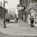 In this May 18, 1940 photo provided by the New York City Municipal Archives, a man reads a newspaper on New York's 6th Ave. and 40th St, with the headline: Nazi Army Now 75 Miles From Paris.