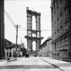 In this June 5, 1908 photo provided by the New York City Municipal Archives, the superstructure from the Manhattan Bridge rises above Washington Street in New York. (AP Photo/New York City Municipal Archives, Department of Bridges/Plant & Structures, Eugene de Salignac)  