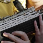 A 6-year-old boy holding a model of the Titanic (AP Photo/Lefteris Pitarakis)