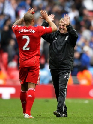 Glen Johnson and Dalglish celebrate victory over Everton.