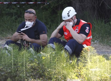 Rescue workers searching for three missing employees at a factory in northern Italy