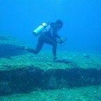 A sport diver tracking hammerhead sharks in 1987 discovered a megalithic temple 82 feet under the East China Sea: solid rock slabs, carved with near right angles in a stepped pyramidal structure; ancient walls and water channels; stone tools and carvings.