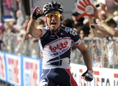 Denmark's Lars Bak celebrates as he crosses the finish line to win the 12th stage of the Giro d'Italia.
