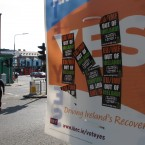 A poster supporting the EU fiscal treaty is defaced by anti-EU stickers