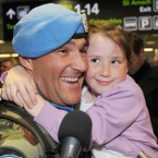 Garrett Wrenne from Cork is welcomed by daughter Rhianna (aged 6) Photo: Laura Hutton/Photocall Ireland