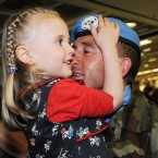 Brian Kelly is welcomed home by daughter Caoimhe (aged 4). Photo: Laura Hutton/Photocall Ireland