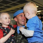 Brian Kelly is welcomed home by daughter Caoimhe (aged 4) and son Rian. Photo: Laura Hutton/Photocall Ireland