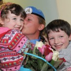 Gemma Donovan is welcomed home by niece Catherine and nephew Patrick. Photo: Laura Hutton/Photocall Ireland