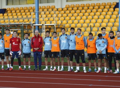 The Spain team observe a minute's silence for Real Betis defender and Liverpool FC youth player, Miki Roque at training.