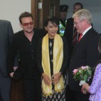 Irish/Burmese 12-year-old girl Sophia Kelly offers flowers to Aung San Suu Kyi while Bill Shipsey of Amnesty Internatonal and U2's Bono look on in Dublin Airport. Photo: Sasko Lazarov/Photocall Ireland