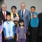 Aung San Suu Kyi with Tanaiste and Minister for Foreign Affairs Eamon Gilmore and Colm O'Gorman, Executive Director of Amnesty and members of the Irish/Burmese community after her arrival in Dublin Airport. Photo: Sasko Lazarov/Photocall Ireland