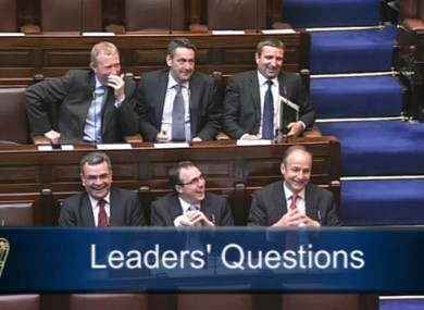 Six Fianna Fáil TDs laughing during Leaders' Questions
