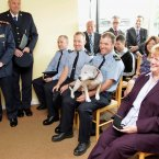 Pictured with 'Angel' sitting on his lap is Sgt William Kirwan, who had saved two Rottweilers who had been reduced to skin and bone. 