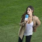 Spanish sports TV presenter Sara Carbonero stands on the pitch prior to the Euro 2012 soccer championship Group C match between  Spain and Italy in Gdansk, Poland, Sunday, June 10, 2012. (AP Photo/Gero Breloer)