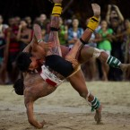Xingu Indians fight during an exhibition of their traditional games at Kari-Oca village, where indigenous groups are staying during the Rio+20 United Nations Conference on Sustainable Development in Rio de Janeiro. (AP Photo/Victor R. Caivano)
