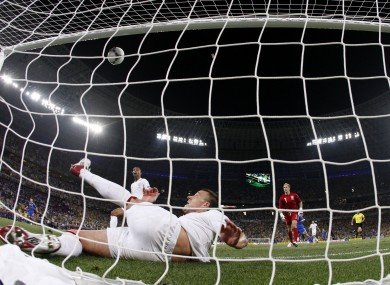 England's John Terry clears the ball away from his goal during the Euro 2012 clash against Ukraine in Donetsk last night.