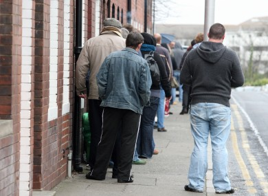People queue at a social welfare office in Dun Laoghaire