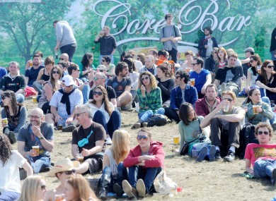 People enjoy the sun at the Forbidden Fruit music festival in Dublin today.