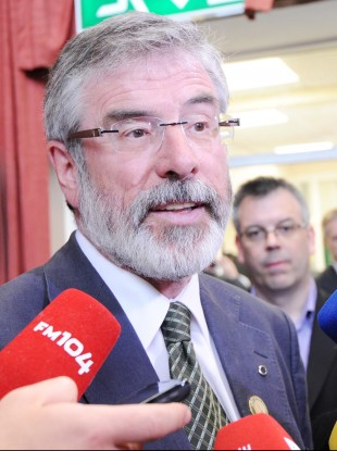 Adams speaks to the media at Dublin Castle yesterday 
