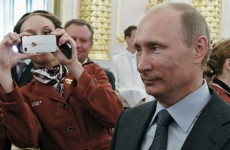 Putin signs law forcing some Russian NGOs to register as 'foreign agents'
