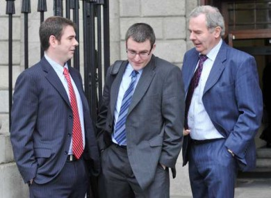 (LtoR) Sean Quinn jnr, Peter Quinn and Sean Quinn snr leave the High Court for lunch on the first day of an eight day contempt hearing