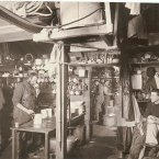 Australian Antarctic Expedition members in the kitchen, 1911-1914. (Image: Frank Hurley)