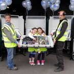 Helping Kai Meyer, left, and Sergei Konosevskis dismantle the e-voting machines are eight-year-old twins Emer, left, and Niamh Gibson. Photo: Mark Stedman/Photocall Ireland