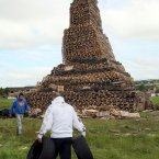 Men carry tyres to the bonfire at New Mossley (Paul Faith/PA Wire)